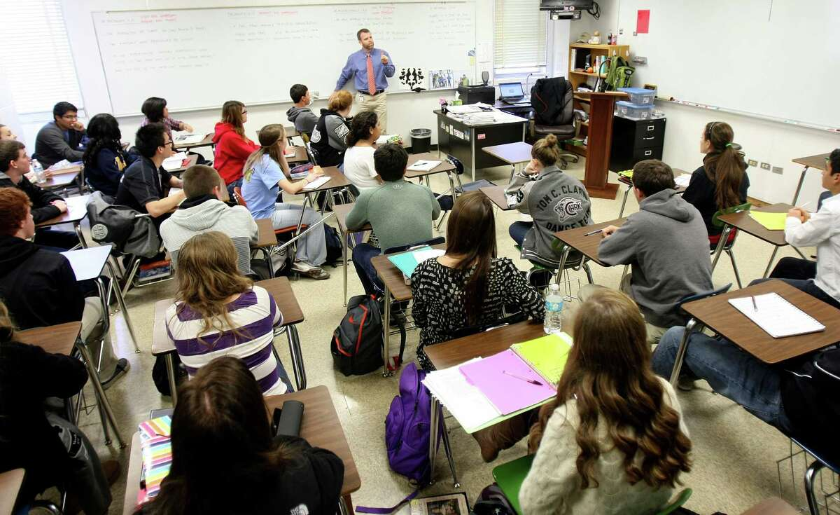 Clark High School teacher Nat Player has 39 students crowded into one of his Advanced Placement psychology courses.