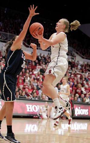 Stanford forward Mikaela Ruef (3) lays-up a shot against Connecticut center Stefanie Dolson (31) during the second half of an NCAA college basketball game in Stanford, Calif., Saturday, Dec. 29, 2012. Connecticut won 61-35. (AP Photo/Tony Avelar) Photo: Tony Avelar, Associated Press / FR155217 AP