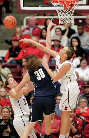 Stanford forward Joslyn Tinkle (44) blocks a shot by Connecticut forward Breanna Stewart (30) as Stanford guard Toni Kokenis (31) looks on during the second half of an NCAA college basketball game in Stanford, Calif., Saturday, Dec. 29, 2012. Connecticut won 61-35. (AP Photo/Tony Avelar) Photo: Tony Avelar, Associated Press / FR155217 AP