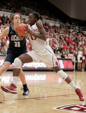 Stanford forward Chiney Ogwumike (13) drives to the basket against Connecticut forward Breanna Stewart (30) during the second half of an NCAA college basketball game in Stanford, Calif., Saturday, Dec. 29, 2012. Connecticut won 61-35. (AP Photo/Tony Avelar) Photo: Tony Avelar, Associated Press / FR155217 AP