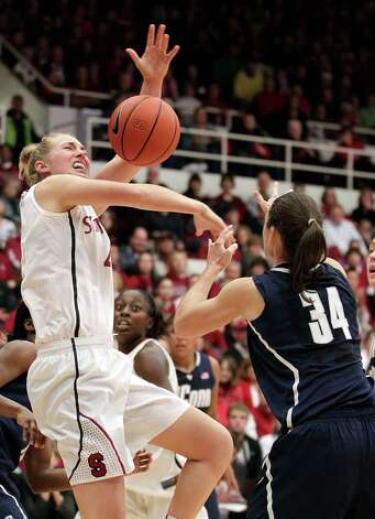 Stanford forward Taylor Greenfield (4) has the ball stripped by Connecticut guard Kelly Faris (34) during the second half of an NCAA college basketball game in Stanford, Calif., Saturday, Dec. 29, 2012. Connecticut won 61-35. (AP Photo/Tony Avelar) Photo: Tony Avelar, Associated Press / FR155217 AP
