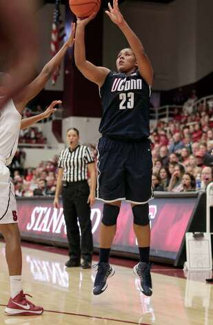 Connecticut forward Kaleena Mosqueda-Lewis (23) takes a 3-point shot against Stanford guard Amber Orrange (33) during the second half of an NCAA college basketball game in Stanford, Calif., Saturday, Dec. 29, 2012. Connecticut won 61-35. (AP Photo/Tony Avelar) Photo: Tony Avelar, Associated Press / FR155217 AP