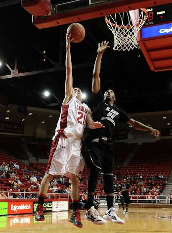 Lamar player Brennan Doty, #21, puts it up for two during the Lamar University mens basketball game against Long Island University at the Montagne Center on December 29, 2012.  Lamar won over LIU 81 - 80. Photo taken: Randy Edwards/The Enterprise