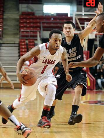 Lamar player Keilan Blanks, #1, charges down the court during the Lamar University mens basketball game against Long Island University at the Montagne Center on December 29, 2012.  Lamar won over LIU 81 - 80. Photo taken: Randy Edwards/The Enterprise