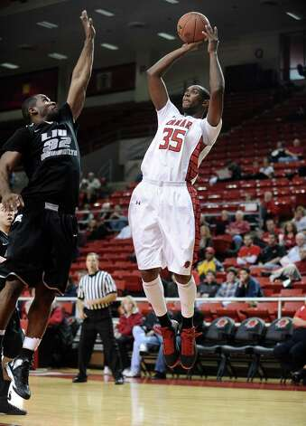 Lamar player Stan Brown, #35, puts it up for two during the Lamar University mens basketball game against Long Island University at the Montagne Center on December 29, 2012.  Lamar won over LIU 81 - 80. Photo taken: Randy Edwards/The Enterprise