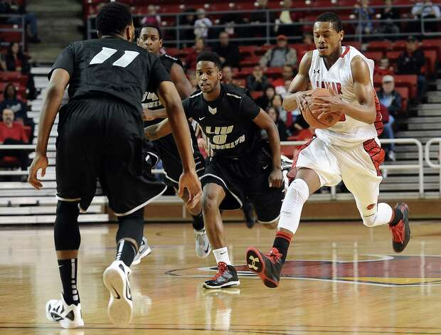 Lamar player Rhon Mitchell, #10, chages down the floor after a steal during the Lamar University mens basketball game against Long Island University at the Montagne Center on December 29, 2012.  Lamar won over LIU 81 - 80. Photo taken: Randy Edwards/The Enterprise