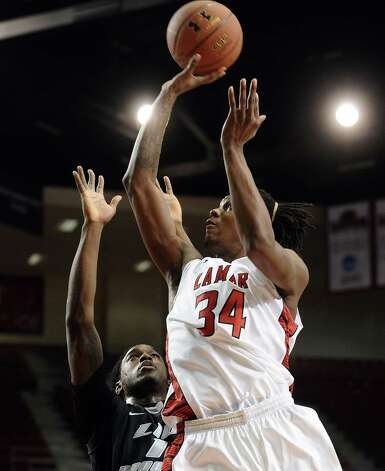 Lamar player Amos Wilson, #34, puts it up for two during the Lamar University mens basketball game against Long Island University at the Montagne Center on December 29, 2012.  Lamar won over LIU 81 - 80. Photo taken: Randy Edwards/The Enterprise