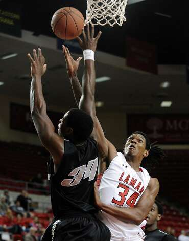 Lamar player Amos Wilsn, #34, puts it up for two during the Lamar University mens basketball game against Long Island University at the Montagne Center on December 29, 2012.  Lamar won over LIU 81 - 80. Photo taken: Randy Edwards/The Enterprise