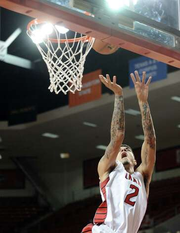 Lamar player Nikko Acosta, #2, puts it up for two during the Lamar University mens basketball game against Long Island University at the Montagne Center on December 29, 2012.  Lamar won over LIU 81 - 80. Photo taken: Randy Edwards/The Enterprise
