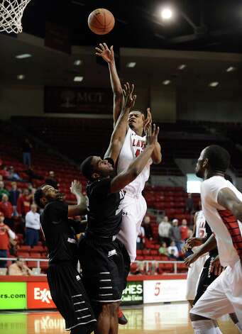 Lamar player Rhon Mitchell, #10, puts it up for two during the Lamar University mens basketball game against Long Island University at the Montagne Center on December 29, 2012.  Lamar won over LIU 81 - 80. Photo taken: Randy Edwards/The Enterprise