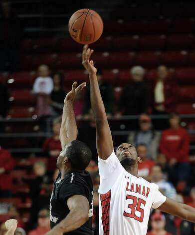 Lamar player Stan Brown, #35, wins the tip during the Lamar University mens basketball game against Long Island University at the Montagne Center on December 29, 2012.  Lamar won over LIU 81 - 80. Photo taken: Randy Edwards/The Enterprise