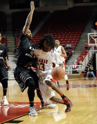 Lamar player Donnell Minton, #3,  charges to the goal during the Lamar University mens basketball game against Long Island University at the Montagne Center on December 29, 2012.  Lamar won over LIU 81 - 80. Photo taken: Randy Edwards/The Enterprise