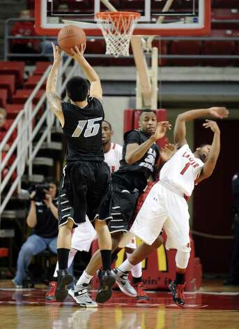 LIU player  Jason Brickman, #15, puts it up fr three during the Lamar University mens basketball game against Long Island University at the Montagne Center on December 29, 2012.  Lamar won over LIU 81 - 80. Photo taken: Randy Edwards/The Enterprise