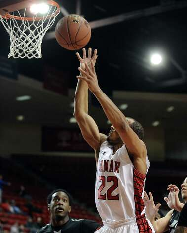 Lamar player Donley Minor, #22, puts it up for two while being fouled during the Lamar University mens basketball game against Long Island University at the Montagne Center on December 29, 2012.  Lamar won over LIU 81 - 80. Photo taken: Randy Edwards/The Enterprise