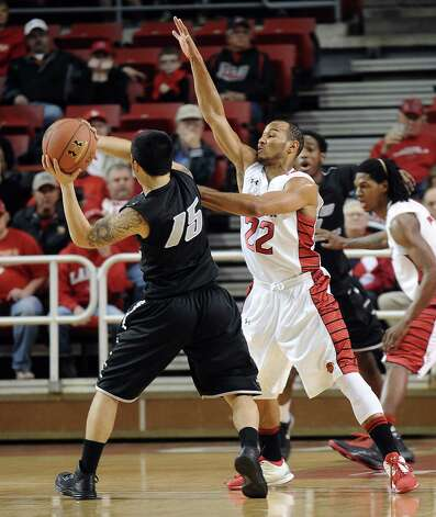 Lamar player Donley Minor, #22, guards LIU player Jason Brickman, #15, during the Lamar University mens basketball game against Long Island University at the Montagne Center on December 29, 2012.  Lamar won over LIU 81 - 80. Photo taken: Randy Edwards/The Enterprise
