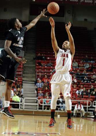 Lamar player Keilan Banks, #1, puts it up for three during the Lamar University mens basketball game against Long Island University at the Montagne Center on December 29, 2012.  Lamar won over LIU 81 - 80. Photo taken: Randy Edwards/The Enterprise