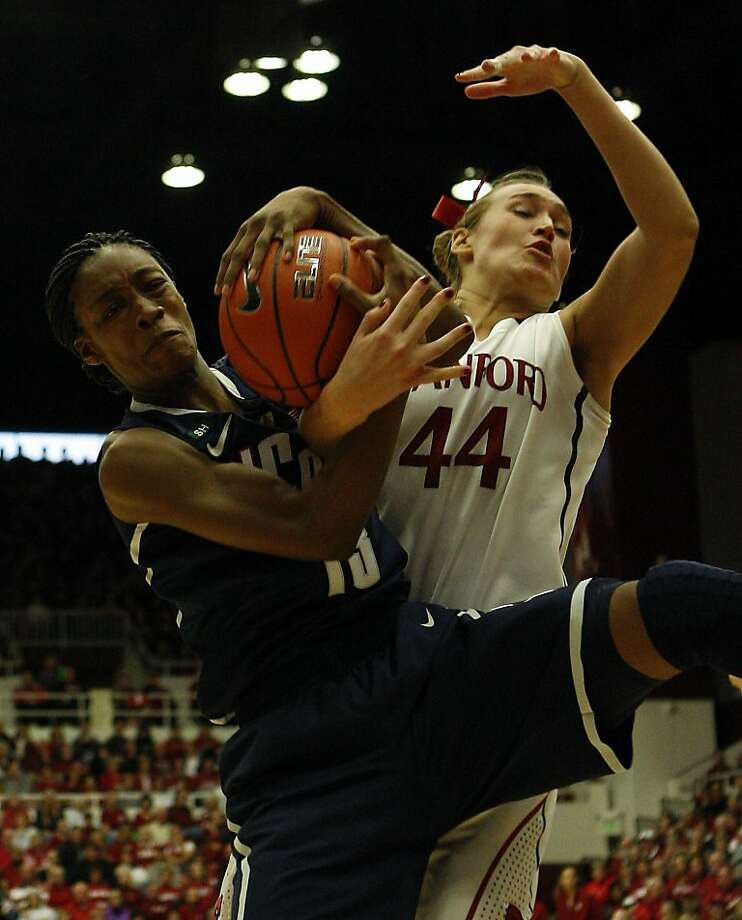 Brianna Banks snares a rebound from Joslyn Tinkle, just as UConn grabbed a win. Photo: Sean Havey, The Chronicle