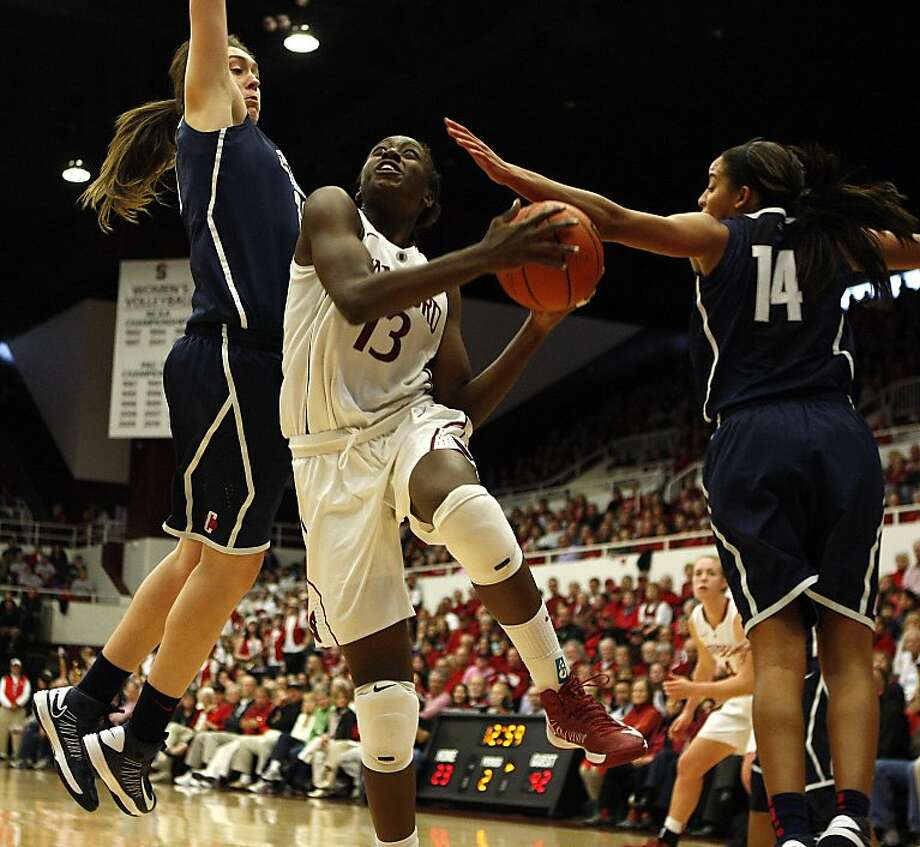 Connecticut swarmed Stanford's Chiney Ogwumike at every turn  and snapped the Cardinal's 82-game home winning streak in convincing fashion. Photo: Sean Havey, The Chronicle