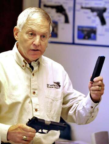 Herb Furhman instructs a National Rifle Association-approved basic pistol safety course in New Milford Saturday, Dec. 29, 2012. Photo: Michael Duffy / The News-Times