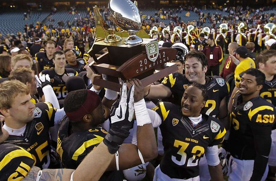 The Sun Devils hoist the champions trohy as Arizona State University beats Navy 62-28 in the Kraft Fight Hunger Bowl at AT&T Park in San Francisco, Calif. on Saturday Dec. 29, 2012. Photo: Michael Macor, The Chronicle