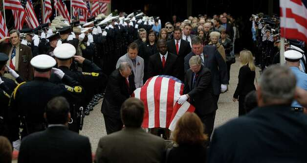Mourners leave the funeral service for Bellaire Police Sgt. Jimmie Norman at Houston First Baptist Church. Photo: Melissa Phillip, Houston Chronicle / © 2012 Houston Chronicle