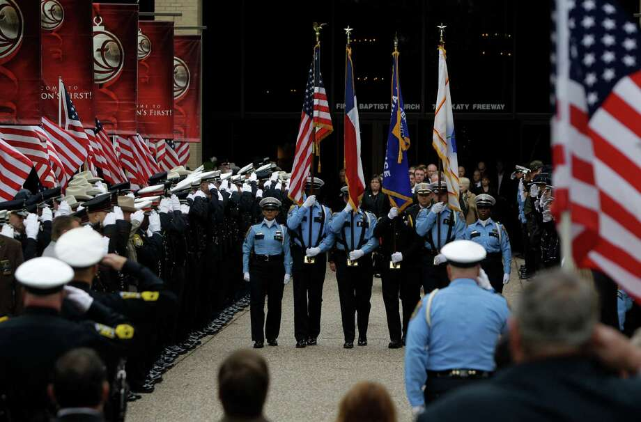 Police officers salute as the casket taken to hearse after funeral service for Bellaire Police Sgt. Jimmie Norman at Houston First Baptist Church. Photo: Melissa Phillip, Houston Chronicle / © 2012 Houston Chronicle