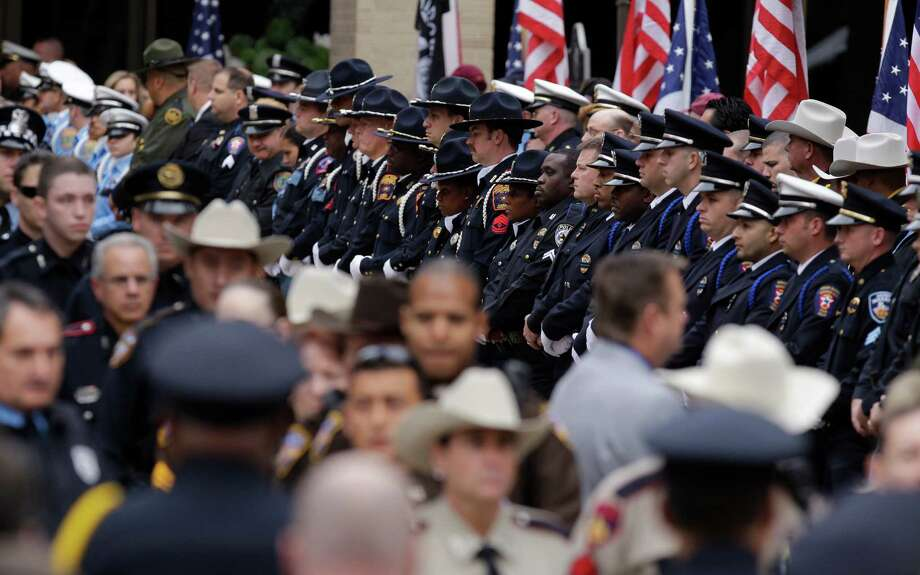 Mourners leave funeral service for Bellaire Police Sgt. Jimmie Norman at Houston First Baptist Church,. Photo: Melissa Phillip, Houston Chronicle / © 2012 Houston Chronicle
