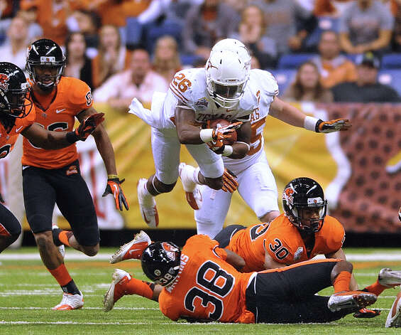 Texas returner D.J. Monroe is upended on a kickoff return during Valero Alamo Bowl action in the Alamodome on Saturday, Dec. 29, 2012. Photo: Billy Calzada, Express-News / SAN ANTONIO EXPRESS-NEWS