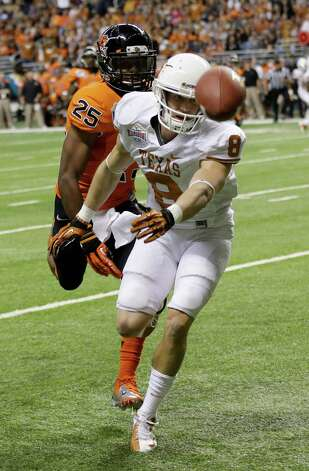 Texas' Jaxon Shipley (8) misses a pass as Oregon State's Ryan Murphy (25) defends during the first quarter of the Alamo Bowl NCAA football game, Saturday, Dec. 29, 2012, in San Antonio.  (AP Photo/Eric Gay) Photo: Eric Gay, Associated Press / AP