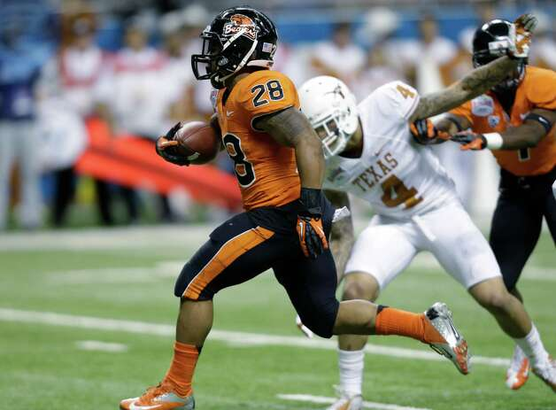 Oregon State's Terron Ward (28) runs past Texas defender Kenny Vaccaro (4) to score a touchdown in the second quarter of the Alamo Bowl NCAA football game, Saturday, Dec. 29, 2012, in San Antonio.  (AP Photo/Eric Gay) Photo: Eric Gay, Associated Press / AP