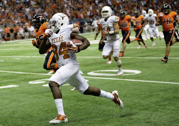 Texas' Marquise Goodwin (84) runs for a 64-yard touchdown during the second quarter of the Alamo Bowl NCAA football game against Oregon State, Saturday, Dec. 29, 2012, in San Antonio.  (AP Photo/Eric Gay) Photo: Eric Gay, Associated Press / AP