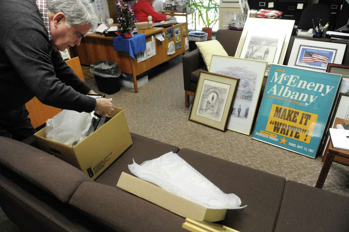Assemblyman Jack McEneny wraps up items and places them in a box as he packed up belongings in his office on the sixth floor of the Legislative Office Building on Thursday, Dec. 20, 2012 in Albany, NY. (Paul Buckowski / Times Union)