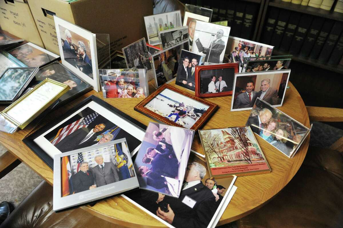 Photographs of Assemblyman Jack McEneny or his family with other politicians are seen on a table in his office as he packed up belongings the sixth floor of the Legislative Office Building on Thursday, Dec. 20, 2012 in Albany, NY. (Paul Buckowski / Times Union)