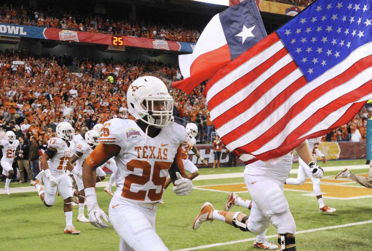The Texas Longhorns take to the field for their Alamo Bowl game matchup against the Oregon State Beavers in the Alamodome on Saturday, Dec. 29, 2012.