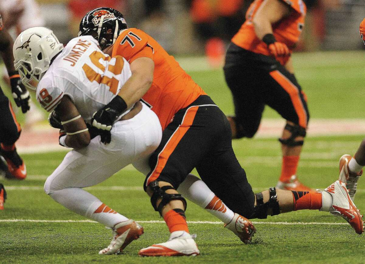 Texas linebacker Peter Jinkens (19) intercepts a pass as Oregon State guard Grant Enger tackles him during Valero Alamo Bowl action in the Alamodome on Saturday, Dec. 29, 2012.