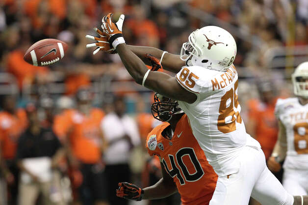 Texas' M.J. McFarland (85) misses a pass against Oregon State's Michael Doctor (40) in the first half of the Valero Alamo Bowl on Saturday, Dec. 29, 2012. Photo: Kin Man Hui, Express-News / © 2012 San Antonio Express-News