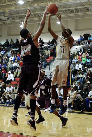 Ozen player Alex Williams, #11, puts it up for two during the Central High School Jaguars basketball game against the Ozen High School Panthers on Saturday, December 29, 2012, at the James Gamble Boys Basketball Tournament championship game held at Port Arthur Memorial High School. Central won over Ozen 76- 73. Photo taken: Randy Edwards/The Enterprise