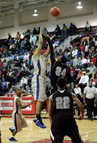 Ozen player Charleton Brydson, #30, puts it up for two during the Central High School Jaguars basketball game against the Ozen High School Panthers on Saturday, December 29, 2012, at the James Gamble Boys Basketball Tournament championship game held at Port Arthur Memorial High School. Central won over Ozen 76- 73. Photo taken: Randy Edwards/The Enterprise