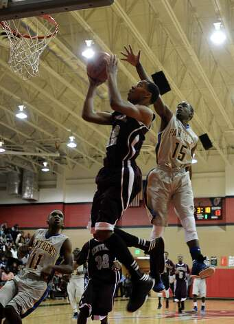 Central player Nijal Pearson, #22, puts it up for two during the Central High School Jaguars basketball game against the Ozen High School Panthers on Saturday, December 29, 2012, at the James Gamble Boys Basketball Tournament championship game held at Port Arthur Memorial High School. Central won over Ozen 76- 73. Photo taken: Randy Edwards/The Enterprise
