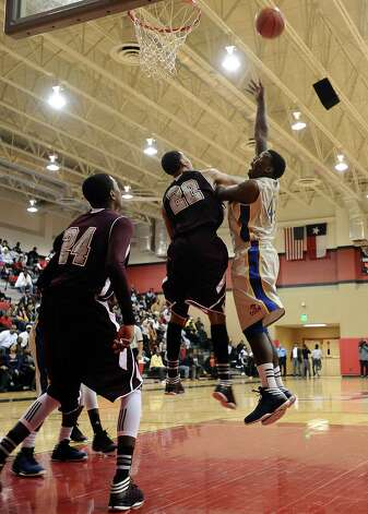 Ozen player Caleb Wright, #44, puts it up for two during the Central High School Jaguars basketball game against the Ozen High School Panthers on Saturday, December 29, 2012, at the James Gamble Boys Basketball Tournament championship game held at Port Arthur Memorial High School. Central won over Ozen 76- 73. Photo taken: Randy Edwards/The Enterprise