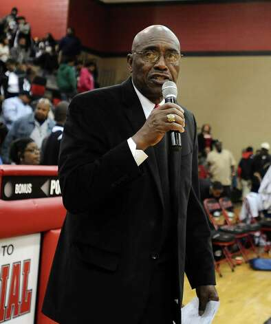 Coach James Gamble speaks after the Central High School Jaguars basketball game against the Ozen High School Panthers on Saturday, December 29, 2012, at the James Gamble Boys Basketball Tournament championship game held at Port Arthur Memorial High School. Central won over Ozen 76- 73. Photo taken: Randy Edwards/The Enterprise