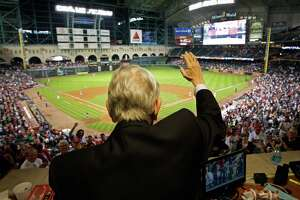 Veteran announcer Milo Hamilton waves and addresses the crowd from the radio booth in the seventh inning of a game between Houston and the St. Louis Cardinals - Hamilton's last home stand as the radio voice of the Astros at Minute Maid Park on Sept. 26.