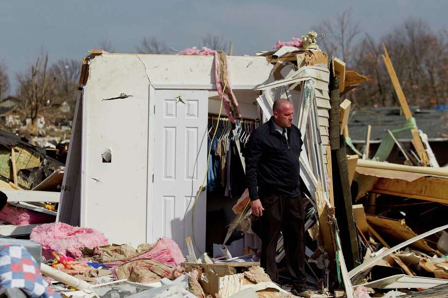Steve McDonald stands debris from the home of his mother-in-law, Mary Osman, who was killed after a tornado touched down February, 29, 2012  in Harrisburg, Illinois. According to reports, at least nine people have died in tornadoes across the Midwest. Photo: Whitney Curtis, Getty Images / 2012 Getty Images