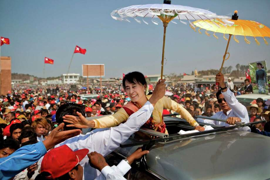 Daw Aung San Suu Kyi campaigning in Aungban, Shan State, Myanmar, Mar. 1, 2012. In April 2012, in a landslide victory, Suu Kyi was elected to Parliament and her party, the National League for Democracy, won nearly every seat in the by-elections, a startling result that showed strong support for the opposition even among government employees and soldiers. Photo: ADAM DEAN, NYT / NYTNS