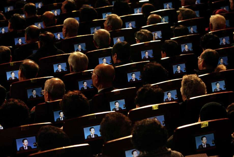 In this March 1, 2012 file photo, small screens show South Korean President Lee Myung-bak as participants listen to his speech during the 93th anniversary ceremony of Independence Movement Day, a public holiday to remember activists who fought for Korean independence against Japanese colonization, in Seoul, South Korea. Photo: Ahn Young-joon, ASSOCIATED PRESS / AP2012