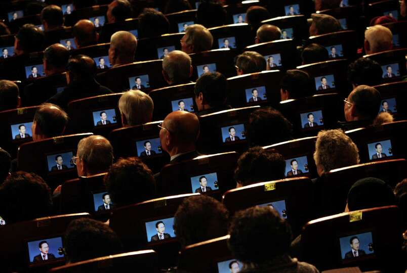 In this March 1, 2012 file photo, small screens show South Korean President Lee Myung-bak as partici
