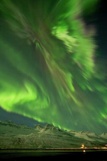 The Northern Lights are seen in the skies near Faskusfjordur on the  east coast of Iceland  Thursday