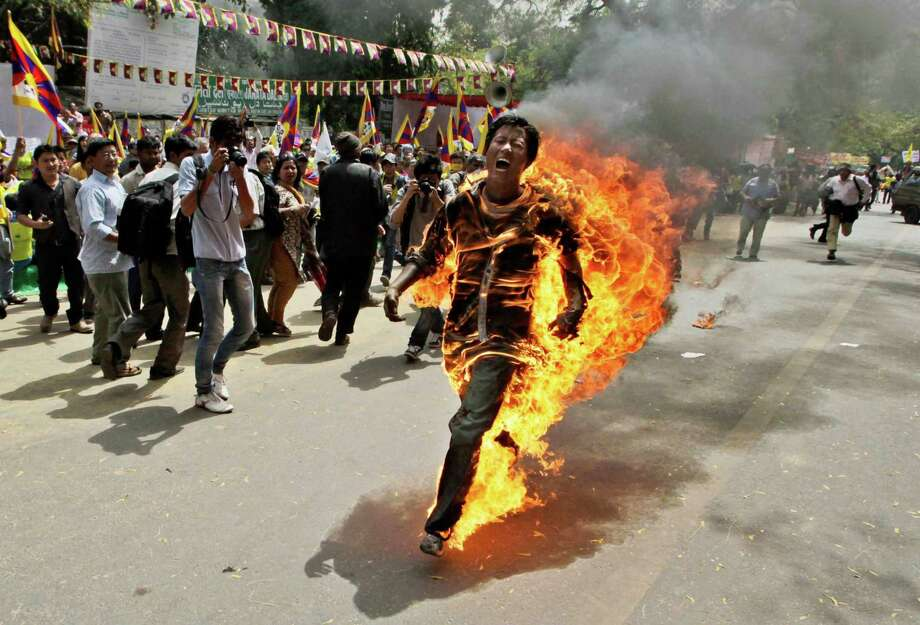 In this March 26, 2012 file photo, Tibetan exile Jamphel Yeshi screams as he runs engulfed in flames after setting himself on fire at a protest in New Delhi, India, against Chinese President Hu Jintao's visit to India. Yeshi died two days later while hundreds of other activists were being held without charge before the president's arrival. Hu arrived in New Delhi for a summit with India, Russia, Brazil and South Africa. Photo: Manish Swarup, ASSOCIATED PRESS / The Associated Press2012