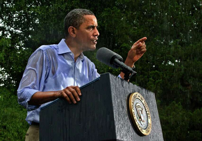 In this July 14, 2012 file photo, President Barack Obama campaigns for re-election in the heavy rain