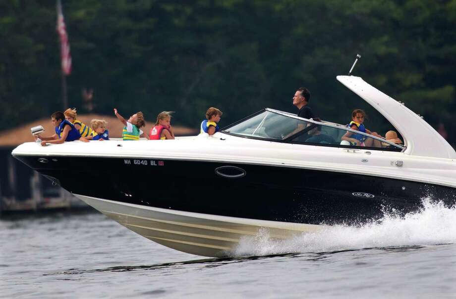 In this July 14, 2012 file photo, Republican presidential candidate, former Massachusetts Gov. Mitt Romney, takes his family for a boat ride on Lake Winnipesaukee in Wolfeboro, N.H. Photo: Evan Vucci, ASSOCIATED PRESS / The Associated Press2012